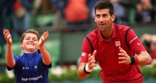 ROLAN GAROS - 11. DAN: Novak pobedio kišu, nervozu i Roberta Bautistu Aguta